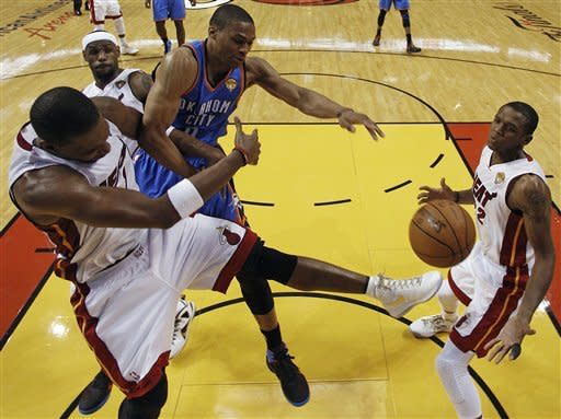 Miami Heat power forward Chris Bosh, left, Oklahoma City Thunder point guard Russell Westbrook (0) and Heat small forward LeBron James (6) lose the rebound as small forward James Jones (22) looks on during the first half at Game 3 of the NBA Finals basketball series, Sunday, June 17, 2012, in Miami. (AP Photo/Lynne Sladky, Pool)