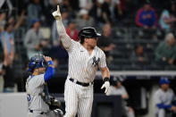 New York Yankees Luke Voit reacts as he watches his game-winning, ninth inning RBI single to defeat the Kansas City Royals 6-5 in a baseball game, Wednesday, June 23, 2021, at Yankee Stadium in New York. Royals catcher Sebastian Rivero, left, watches the ball's path. (AP Photo/Kathy Willens)