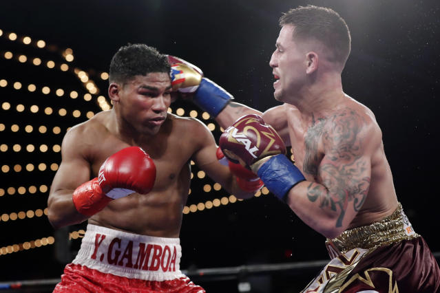 FILE - In this Nov. 25, 2017, file photo, Cuba's Yuriorkis Gamboa, left, fights Jason Sosa during the 10th round of a super featherweight boxing match in New York. Eager to take his career to a higher level, Gervonta Davis will move up to fight Cubas Yuriorkis Gamboa for the WBAs secondary lightweight title. AP Photo/Frank Franklin II, File)