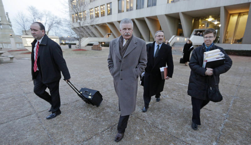 Will County States Attorney James Glasgow, center and his prosecutorial team leave the Will County Courthouse Wednesday, Feb. 20, 2013, in Joliet, Ill., after the second day of a hearing in the former suburban Chicago police officer's request for a new trial. The defense is seeking to bolster arguments Peterson deserved a retrial on charges he murdered his third wife, Kathleen Savio. Peterson's attorneys contend his former lead trial attorney, Joel Brodsky, botched his case. After two days of arguments Judge Edward Burmila said he would deliver his ruling when court resumes at 1 p.m. Thursday. (AP Photo/M. Spencer Green)