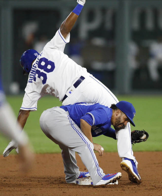 Kansas City Royals' Jorge Bonifacio (38) is tagged out at second base by Toronto Blue Jays second baseman Devon Travis while attempting to stretch a single into a double during the second inning of a baseball game at Kauffman Stadium in Kansas City, Mo., Thursday, Aug. 16, 2018. (AP Photo/Colin E. Braley)