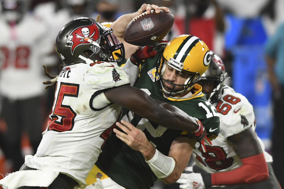 FILE - Tampa Bay Buccaneers inside linebacker Devin White (45) sacks Green Bay Packers quarterback Aaron Rodgers (12) during the second half of an NFL football game in Tampa, Fla., in this Sunday, Oct. 18, 2020, file photo. Rodgers had his worst game of the season in Green Bay's 38-10 loss at Tampa Bay Back on Oct. 18, as he threw two game-changing interceptions and completed less than half his pass attempts. Rodgers gets a chance to make amends for that performance Sunday when the top-seeded Packers host the Bucs in the NFC championship game. (AP Photo/Jason Behnken, File)