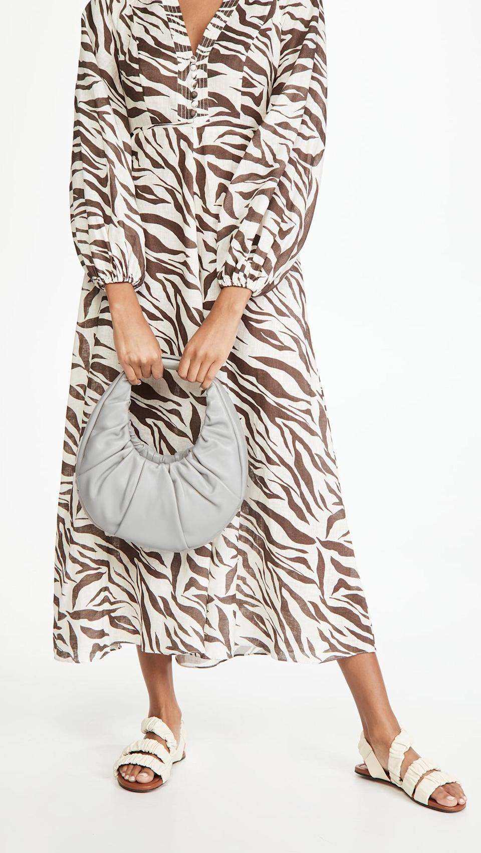 <p>This <span>Staud Soft Moon Bag</span> ($395) comes in several neutral shades, but this pretty light-gray choice is perfect.</p>