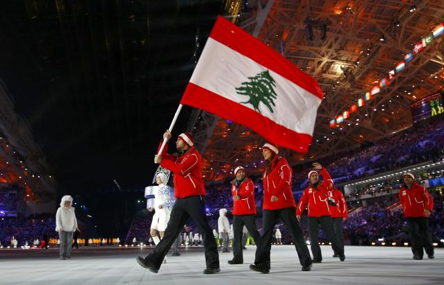Lebanon's flag-bearer Alexandre Mohbat leads his country's delegation during the opening ceremony of the 2014 Sochi Winter Olympic Games at Fisht stadium February 7, 2014. REUTERS/Brian Snyder (RUSSIA - Tags: OLYMPICS SPORT)