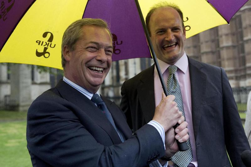 Feud: The former Ukip leader Nigel Farage claimed the MP was 'never Ukip' and had 'sought to undermine us' (AP)