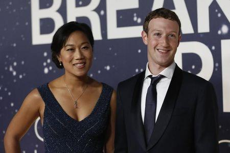 Mark Zuckerberg, founder and CEO of Facebook, and wife Priscilla Chan arrive on the red carpet during the 2nd annual Breakthrough Prize Award in Mountain View, California