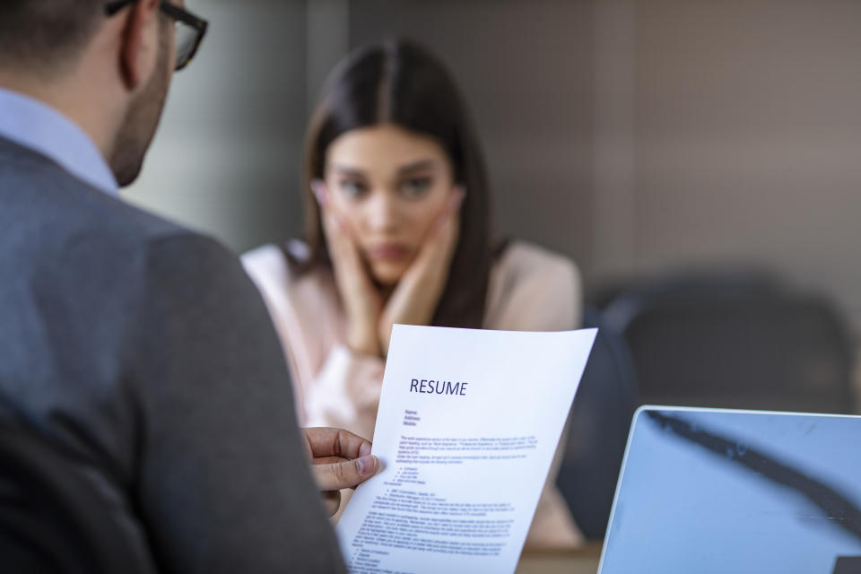 Nervous young job applicant wait for recruiters question during interview in office, worried intern or trainee feel stressed applying for open position, meeting with hr managers. Hiring concept