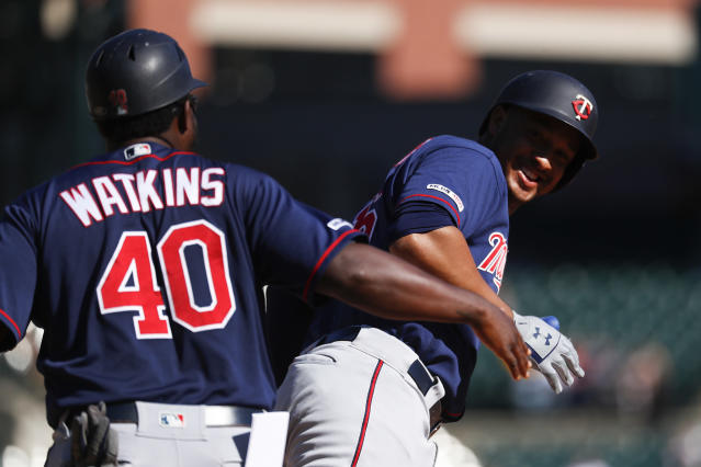 Minnesota Twins' Jonathan Schoop celebrates his two-run home run with first base coach Tommy Watkins (40) in the seventh inning of a baseball game against the Detroit Tigers in Detroit, Thursday, Sept. 26, 2019. (AP Photo/Paul Sancya)