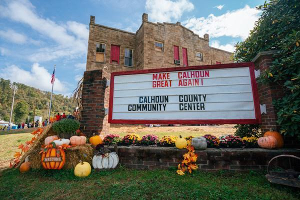 """A """"Make Calhoun Great Again"""" sign greeted the 900 people who attended Saturday's ceremonial brick-breaking. Roger Hanshaw, Speaker of the West Virginia House of Delegates, spoke to the assembled crowd and  hailed The 1982 Foundation's efforts as an example of how """"we as communities can change our destiny."""""""