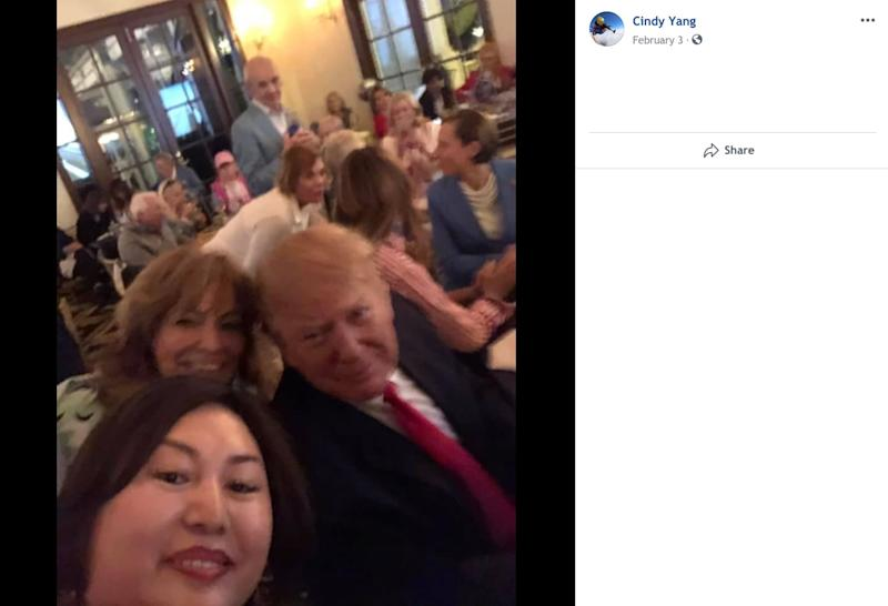"""A screenshot taken from Li """"Cindy"""" Yang's Facebook page shows her seated behind the president. (Photo: )"""