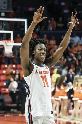 FILE - In this March 8, 2020, file photo, Illinois' Ayo Dosunmu (11) celebrates a 78-76 win over Iowa in the second half of an NCAA college basketball game in Champaign, Ill. Dosunmu was selected to the Associated Press All-Big Ten team selected Tuesday, March 10, 2020. (AP Photo/Holly Hart, File)