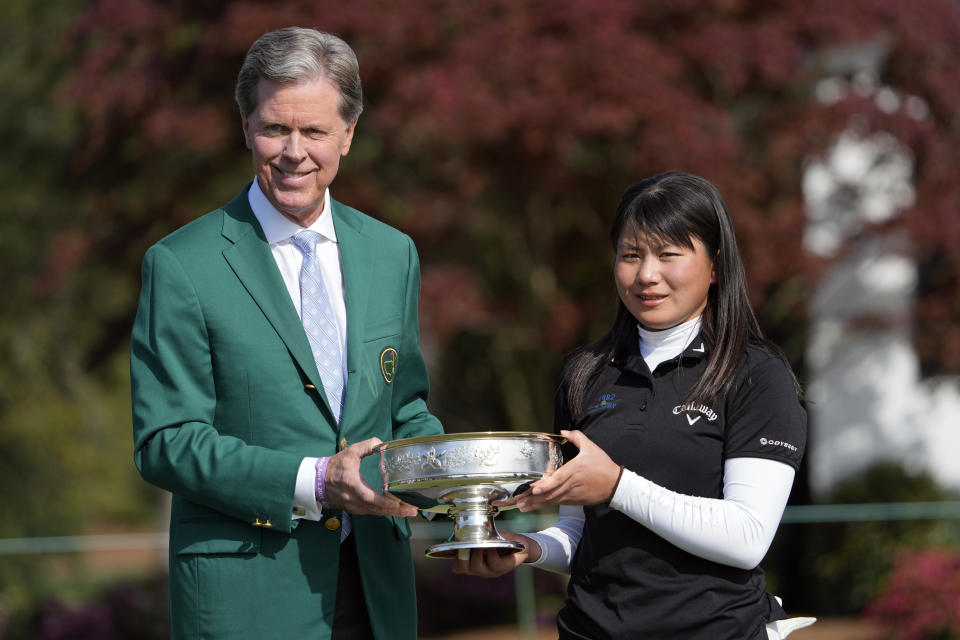 Tsubasa Kajitani, right, and Augusta National Golf Club Chairman Fred Ridley pose with the winner's trophy after Kajitani won the Augusta National Women's Amateur golf tournament on Saturday. (AP Photo/David J. Phillip)