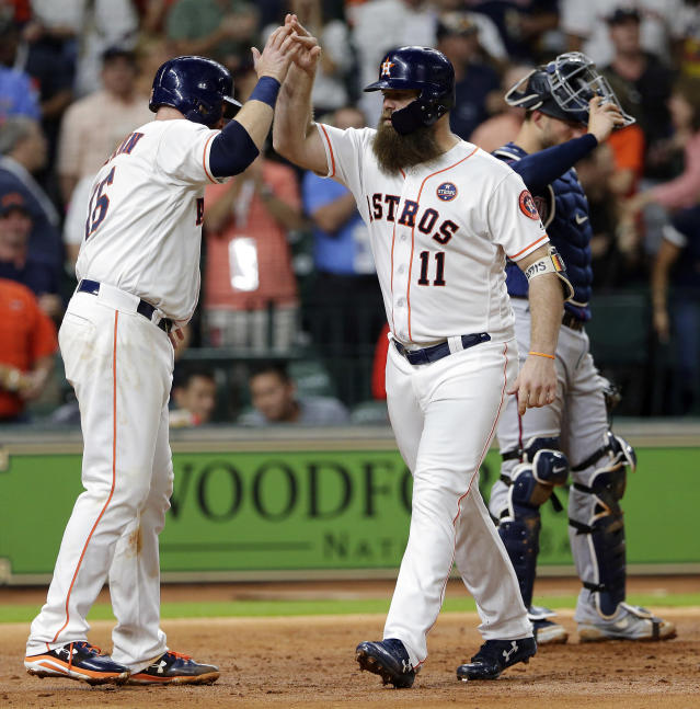 Houston Astros' Brian McCann (16) and Evan Gattis (11) celebrate at the plate, next to Minnesota Twins catcher Mitch Garver (23), after they scored on a two-run home run by Gattis during the fourth inning of a baseball game Wednesday Sept. 5, 2018, in Houston. (AP Photo/Michael Wyke)