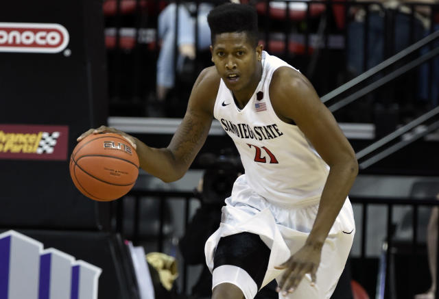 "San Diego State's <a class=""link rapid-noclick-resp"" href=""/ncaab/players/126579/"" data-ylk=""slk:Malik Pope"">Malik Pope</a> was named in documents discovered in a federal investigation. (AP)"