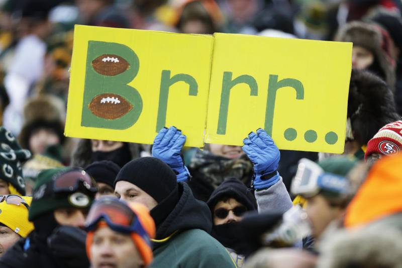 A fan holds up a sign during the first half of an NFL wild-card playoff football game between the Green Bay Packers and the San Francisco 49ers, Sunday, Jan. 5, 2014, in Green Bay, Wis. (AP Photo/Jeffrey Phelps)