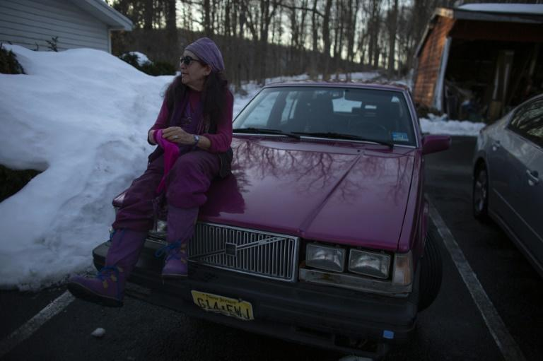 "Sandra Ramos director of the shelter ""Strengthen Our Sisters"" sits on top of her car in Paterson, New Jersey on February 25, 2021"