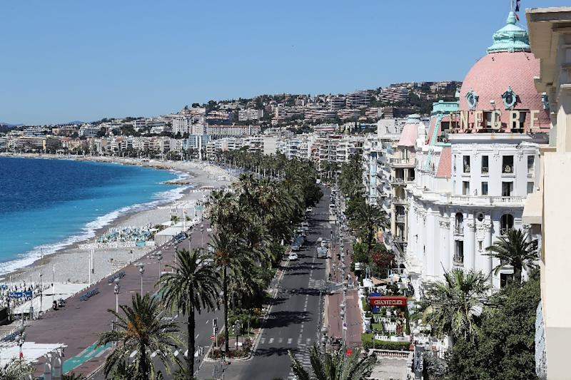 A gunman drove a 19-tonne truck into a crowd of revellers in the French Riviera town of Nice, following Bastille Day fireworks, killing at least 84 people (AFP Photo/Valery Hache)