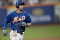 New York Mets' Jeff McNeil runs to third base during the first inning in the second game of a baseball doubleheader against the Miami Marlins, Monday, Aug. 5, 2019, in New York. (AP Photo/Mary Altaffer)