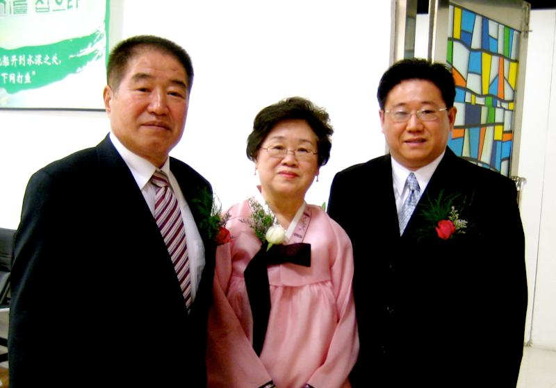 In this undated photo provided by the family of Kenneth Bae, Kenneth Bae, right, poses for a photo with his parents, Sung Seo Bae, left, and Myunghee Bae, center. Bae, a 45-year-old tour operator and Christian missionary was arrested last November while leading a group of tourists in the northeastern region of Rason in North Korea and has been detained for the past 11 months. Bae's family said on Thursday, Oct. 10, 2013, that Bae's mother, Myunghee Bae, is being allowed to visit him. (AP Photo/Courtesy Terri Chung)