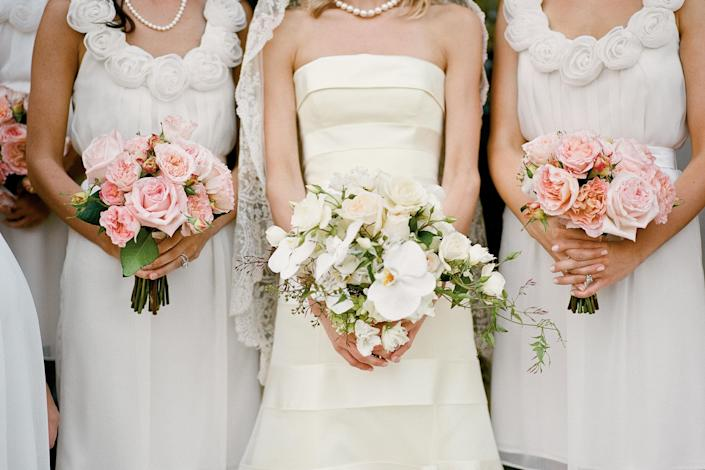 """<p>Ann Stewart's decision to have her bridesmaids wear white contributed to the classic but simple aesthetic. """"I didn't want to be the only one in white,"""" she says.</p> <p><strong>Love It? Get It!</strong><br><strong>Bridesmaids' Dresses:</strong> Lela Rose, <a href=""""http://lelarose.com/"""" rel=""""nofollow noopener"""" target=""""_blank"""" data-ylk=""""slk:lelarose.com"""" class=""""link rapid-noclick-resp"""">lelarose.com</a>.</p>"""
