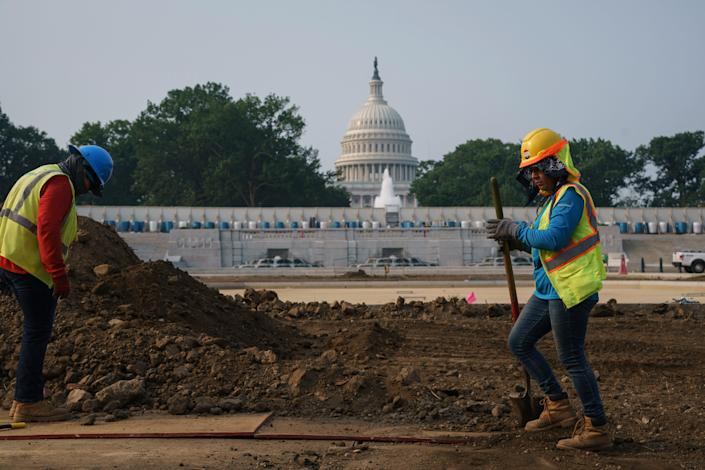 Infrastructure workers near the U.S. Capitol on July 21, 2021.