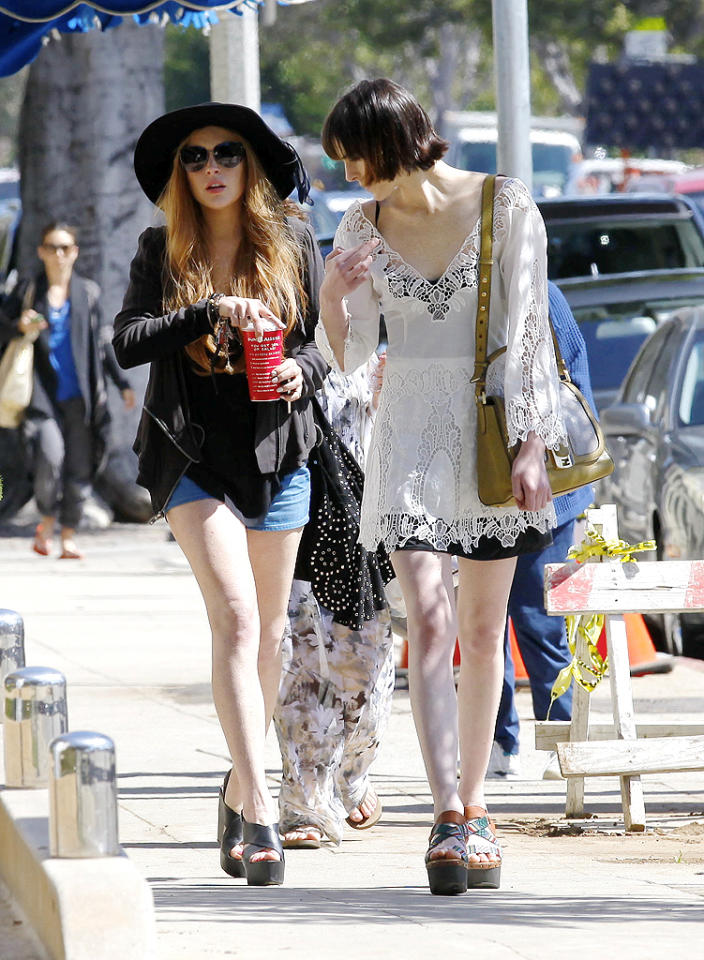 """<p class=""""MsoNormal"""">Exiting the restaurant, the sisters showed off their long legs in mile-high platform sandals. (4/10/2012)</p>"""