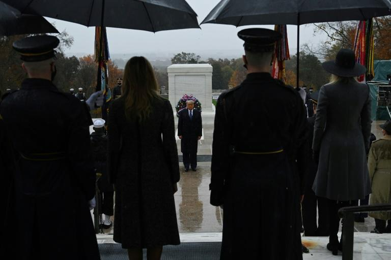 US President Donald Trump (center) attends a wreath-laying ceremony to mark Veterans Day on November 11, 2020 at Arlington National Cemetery in Arlington, Virginia