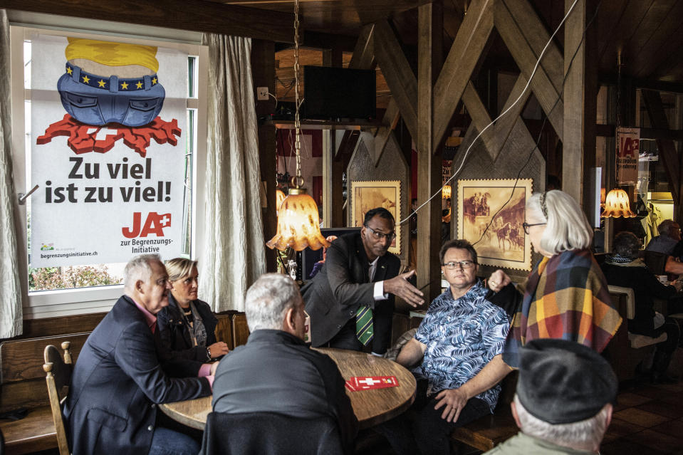 SVP party members will gather for their limitation initiative in a restaurant, Sunday, 27 September 2020, in Rothrist, Switzerland. The Swiss electorate has to decide on five Swiss proposals. The initiative 'For moderate immigration (Limitation Initiative)' launched by Swiss People's Party SVP is one of five separate issues Swiss voters will decide in the nationwide ballot on 27 September 2020. (Peter Schneider/Keystone via AP)
