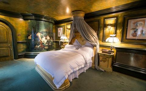 The master bedroom has art inspired by ancient Greek legends, including a hand-painted recreation of John William Waterhouse's Hylas and the Nymphs - Credit: Heathcliff O'Malley for the Telegraph