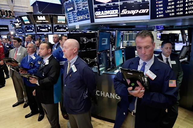 <p>Traders on the floor of the New York Stock Exchange, Tuesday, May 23, 2017, observe a moment of silence in the wake of the attack in Manchester, England. (AP Photo/Richard Drew) </p>