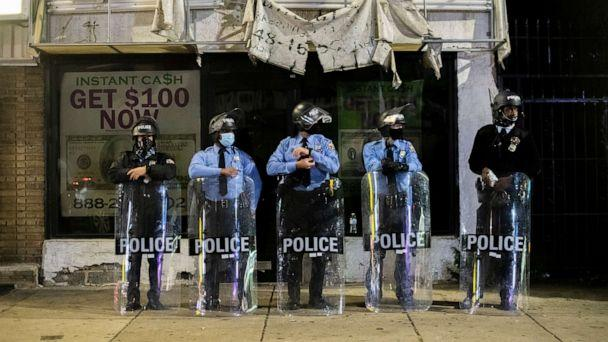 PHOTO: PHILADELPHIA, PA - OCTOBER 28:  Police officers congregate an hour before a citywide curfew, on October 28, 2020 in Philadelphia, Pennsylvania.  (Mark Makela/Getty Images)