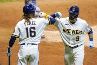 Milwaukee Brewers' Manny Pina is congratulated by Ben Gamel after hitting a two-run home run during the sixth inning of a baseball game against the Minnesota Twins Tuesday, Aug. 11, 2020, in Milwaukee. (AP Photo/Morry Gash)