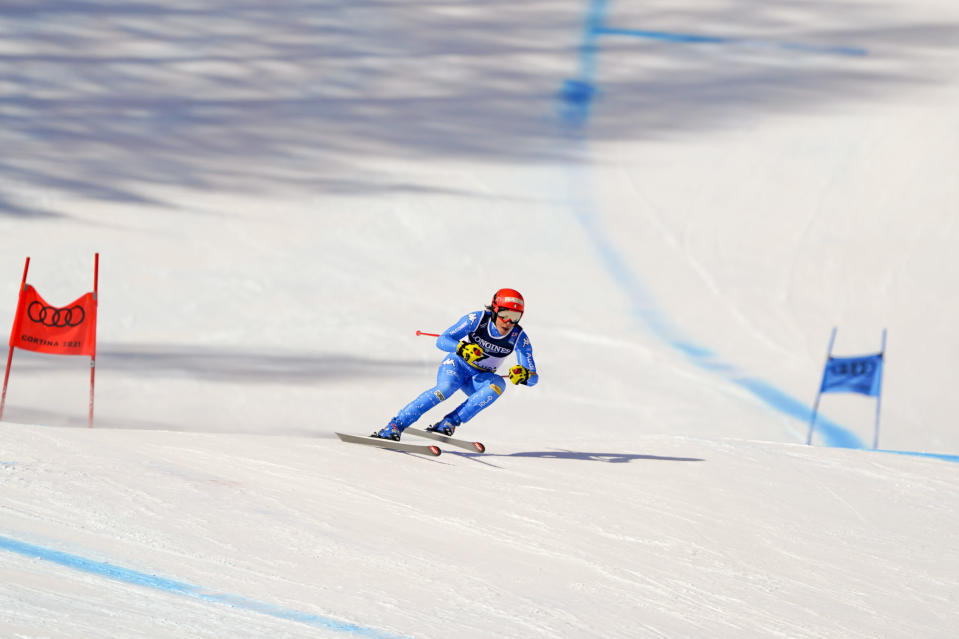 Italy's Federica Brignone speeds down the course during the super G portion of the women's combined race, at the alpine ski World Championships, in Cortina d'Ampezzo, Italy, Monday, Feb. 15, 2021. (AP Photo/Giovanni Auletta)
