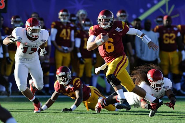Southern California quarterback Cody Kessler (6) carries the ball against Fresno State during the third quarter of the Las Vegas Bowl NCAA college football game, Saturday, Dec. 21, 2013, in Las Vegas. USC won 45-20. (AP Photo/David Cleveland)