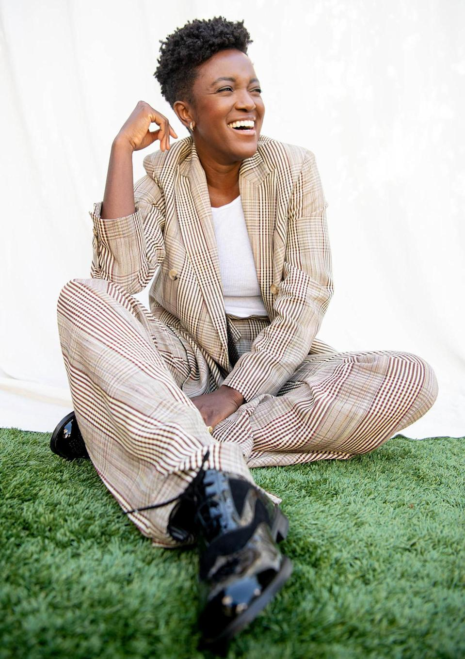 <p>Krys Marshall is beaming during a <em>For All Mankind</em> photoshoot.</p>