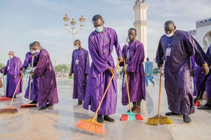 Organizers clean the Great Mosque of Touba during the Grand Magal of Mourides in Touba on September 26, 2021, the largest annual muslim pilgrimage in Senegal, with hundreds of thousands making the pilgrimage each year.