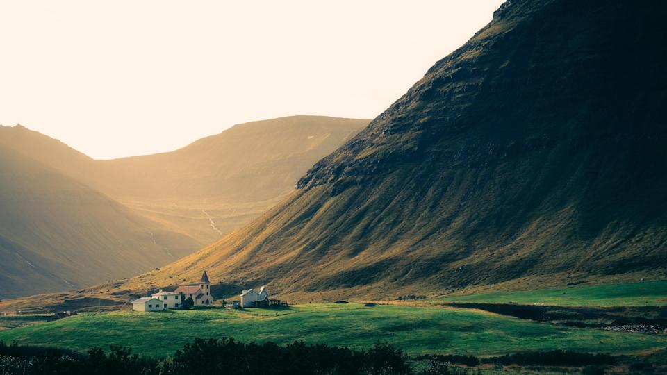 """Located in Iceland's gorgeous Westfjords peninsula, the <a href=""""https://www.cntraveler.com/gallery/25-most-beautiful-small-towns-in-europe?mbid=synd_yahoo_rss"""" rel=""""nofollow noopener"""" target=""""_blank"""" data-ylk=""""slk:tiny town"""" class=""""link rapid-noclick-resp"""">tiny town</a> of Ísafjörður (population 2,571) is nearly swallowed by the towering mountains around it. With winter temperatures dipping down to 20 degrees Fahrenheit and summer temperatures rarely above the mid-50s, Ísafjörður is the antithesis of your trusty Italian and Greek resort towns—and therein lies its appeal for those who prefer their vacations more rugged than ritzy."""