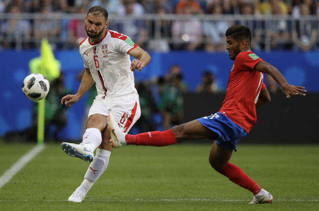 Costa Rica's Johan Venegas fights for the ball against Serbia's Branislav Ivanovic during the group E match between Costa Rica and Serbia at the 2018 soccer World Cup in the Samara Arena in Samara, Russia, Sunday, June 17, 2018. (AP Photo/Mark Baker)
