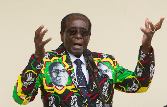 <p>Mugabe addresses people at an event during his party's 16th Annual Peoples Conference in Masvingo, Zimbabwe, in December 2016. (Photo: Tsvangirayi Mukwazhi/AP) </p>