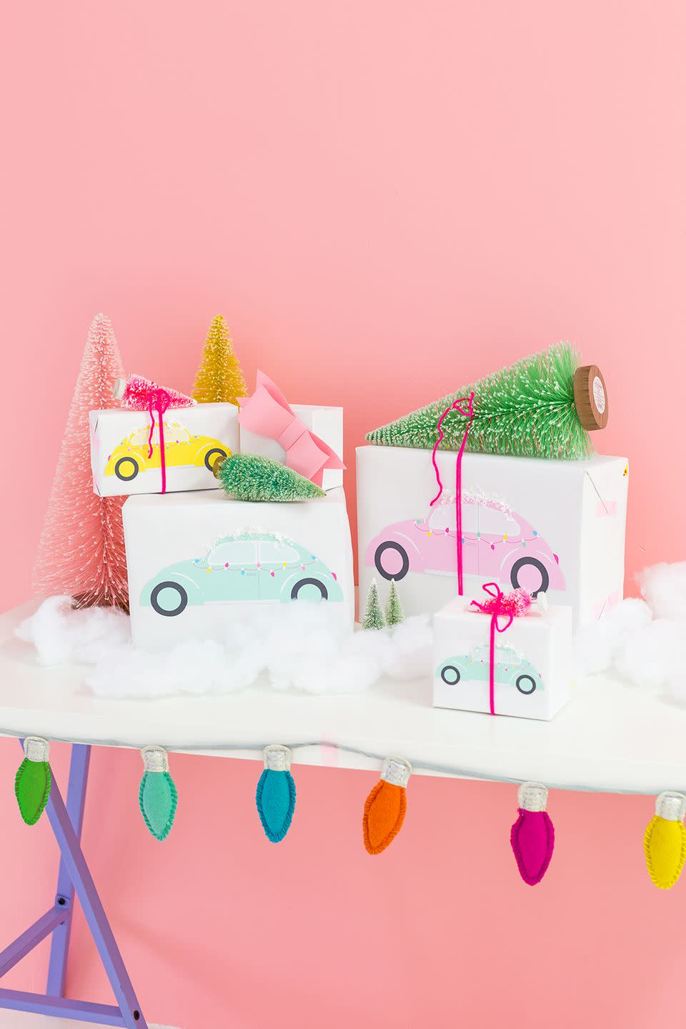 """<p>Combine a free retro car printable with an inexpensive bottle brush tree to create a super cute and unique gift wrap. </p><p>Get the tutorial at <a href=""""http://www.awwsam.com/2017/12/diy-bottle-brush-car-gift-wrap.html"""" rel=""""nofollow noopener"""" target=""""_blank"""" data-ylk=""""slk:Aww Sam"""" class=""""link rapid-noclick-resp"""">Aww Sam</a>.</p><p><a class=""""link rapid-noclick-resp"""" href=""""https://www.amazon.com/Whaline-Christmas-Artificial-Tabletop-Ornaments/dp/B081H2ZCWT?tag=syn-yahoo-20&ascsubtag=%5Bartid%7C10072.g.34015639%5Bsrc%7Cyahoo-us"""" rel=""""nofollow noopener"""" target=""""_blank"""" data-ylk=""""slk:SHOP BOTTLE BRUSH TREES"""">SHOP BOTTLE BRUSH TREES</a></p>"""