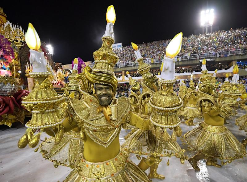 Members of the Viradouro school samba through the 700 meter Sambradrome in Rio's carnival: each school fields hundreds, if not thousands, of dancers, as well as floats and drummers (AFP Photo/CARL DE SOUZA)