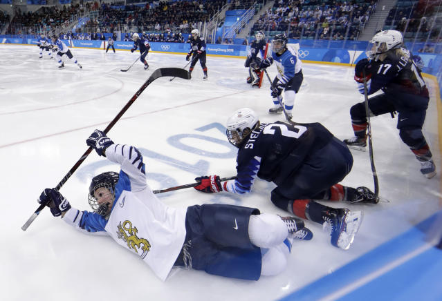 <p>Annina Rajahuhta, left, of Finland, falls after colliding with Lee Stecklein (2), of the United States, during the third period of the semifinal round of the women's hockey game at the 2018 Winter Olympics in Gangneung, South Korea, Monday, Feb. 19, 2018. (AP Photo/Matt Slocum) </p>