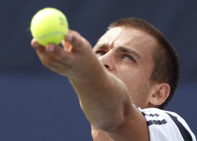 Mikhail Youzhny of Russia serves to Alexandr Dolgopolov of Ukraine at the U.S. Open tennis championships in New York August 30, 2013. REUTERS/Adam Hunger (UNITED STATES - Tags: SPORT TENNIS)