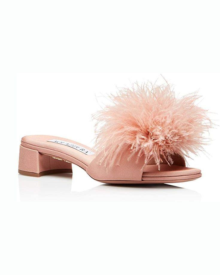 """<p><strong>Aquazzura</strong></p><p>amazon.com</p><p><strong>$365.00</strong></p><p><a href=""""https://www.amazon.com/dp/B092G5VN52?tag=syn-yahoo-20&ascsubtag=%5Bartid%7C10051.g.36683138%5Bsrc%7Cyahoo-us"""" rel=""""nofollow noopener"""" target=""""_blank"""" data-ylk=""""slk:SHOP NOW"""" class=""""link rapid-noclick-resp"""">SHOP NOW</a></p><p>Looking at your calendar for the next few months and realizing stuff has actually been popping on there like crazy? Get set to go out again with a fun pair of slides.</p>"""