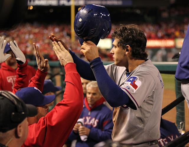 ST LOUIS, MO - OCTOBER 20: Ian Kinsler #5 of the Texas Rangers celebrates in the dugout after scoring to tie the game in the ninth inning during Game Two of the MLB World Series against the St. Louis Cardinals at Busch Stadium on October 20, 2011 in St Louis, Missouri. (Photo by Jamie Squire/Getty Images)