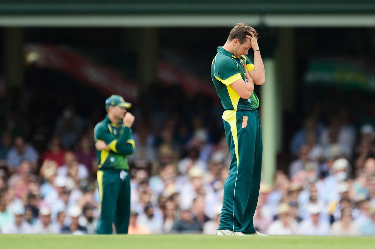 SYDNEY, AUSTRALIA - JANUARY 19: James Pattinson of Australia reacts after being hit for four during game three of the One Day International Series between Australia and England at Sydney Cricket Ground on January 19, 2014 in Sydney, Australia.  (Photo by Brett Hemmings/Getty Images)