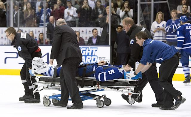 Toronto Maple Leafs' Paul Ranger is taken off the ice on a stretcher after hitting the boards head first from a check by Tampa Bay Lightning's Alex Killorn during first period NHL action in Toronto on Wednesday March 19, 2014. (AP Photo/The Canadian Press, Frank Gunn)