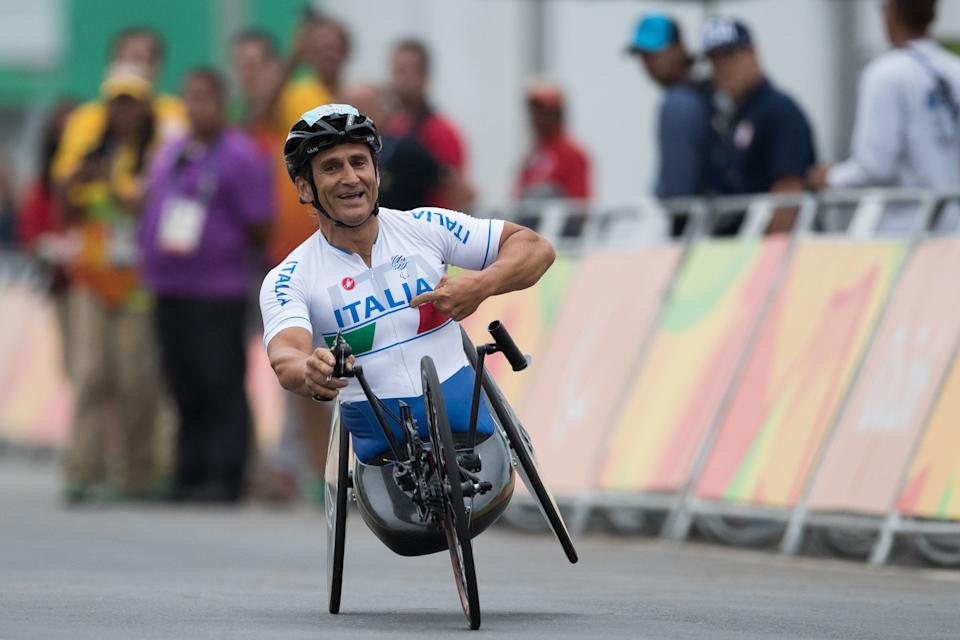 Italy's Alessandro Zanardi celebrates after winning gold medal at the men's team relay H2-5 road cycling event at the Rio 2016 Paralympic games at Pontal beach in Rio de Janeiro, Brazil, Sept. 16, 2016. (AP Photo/Mauro Pimentel)