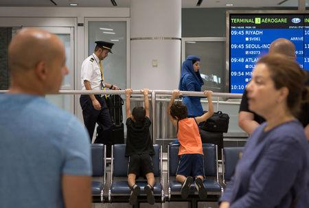 People arrive at Toronto Pearson International Airport from Saudi Airlines flight from Riyadh in Toronto