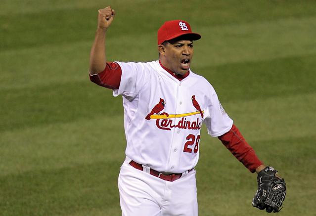 ST LOUIS, MO - OCTOBER 28: Octavio Dotel #28 of the St. Louis Cardinals celebrates after getting the third out of the seventh inning during Game Seven of the MLB World Series against the Texas Rangers at Busch Stadium on October 28, 2011 in St Louis, Missouri. (Photo by Doug Pensinger/Getty Images)